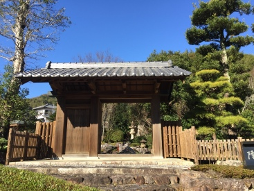 gate (mon) at Japanese garden with Japanese pine tree