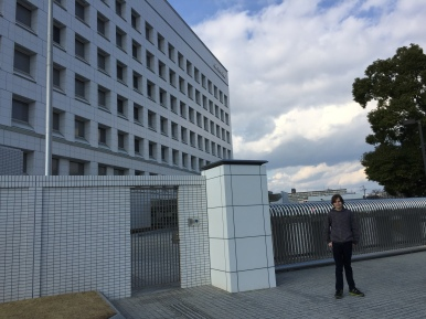 Boy in front of gates at Nintendo headquarters