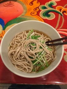 a bowl of toshi-koshi soba for new year's eve on a beautiful table