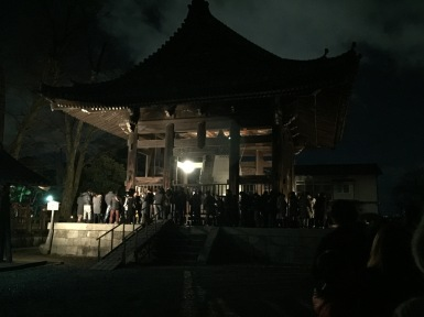 people waiting in line to ring the bell at hoko-ji temple kyoto joyanokane