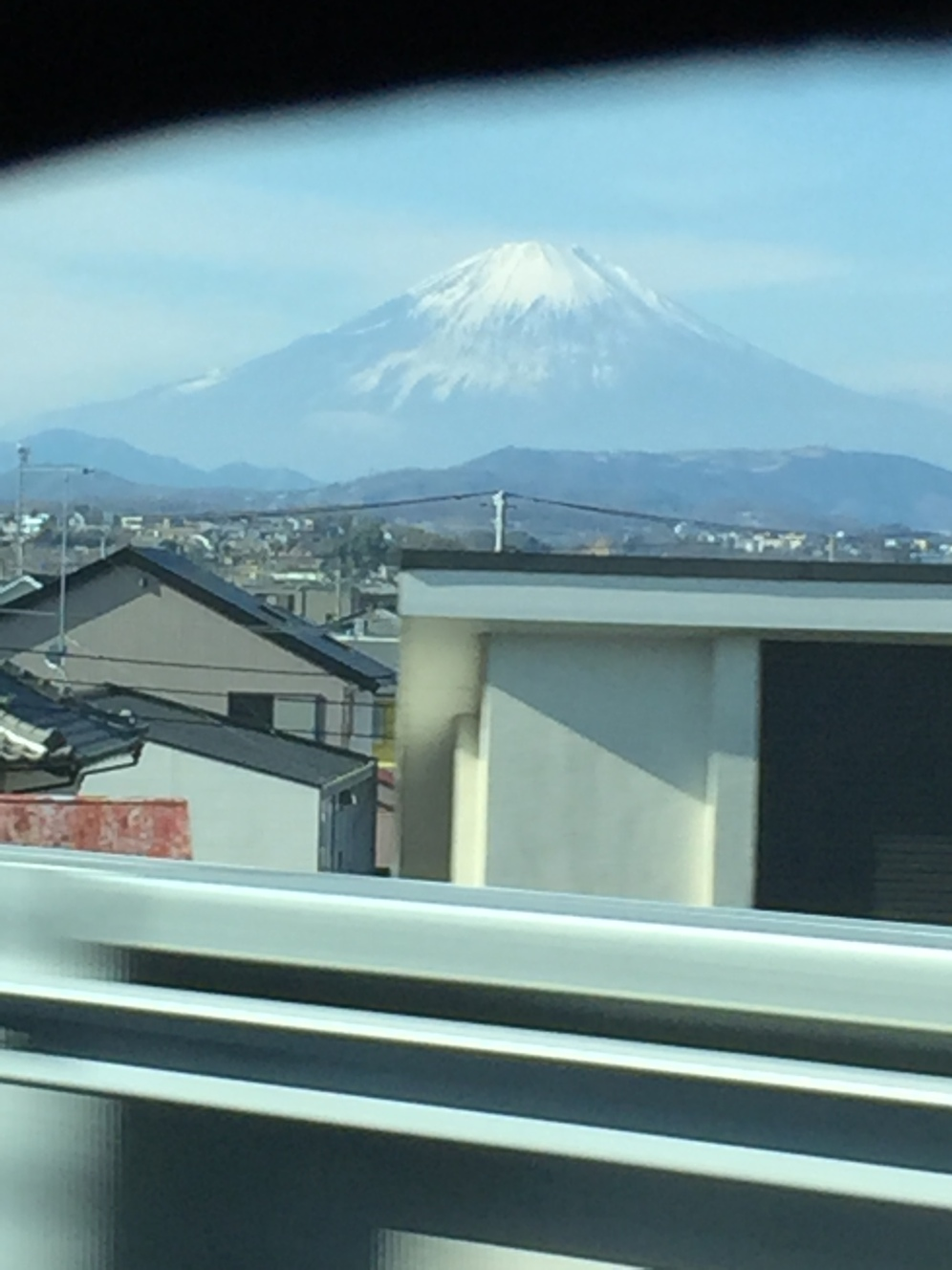 snow covered mount fuji with suburban image in foreground