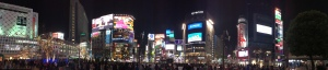 a panaromic night time shot of Shibuya crossing area tokyo