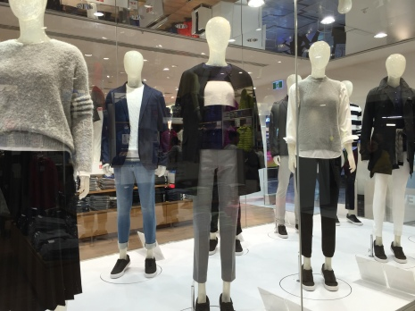 mannequins at Uniqlo in the window on rotating display with funky Japanese winter clothes