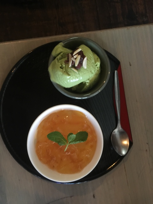 frozen yuzu pudding with a scoop of matcha icecream