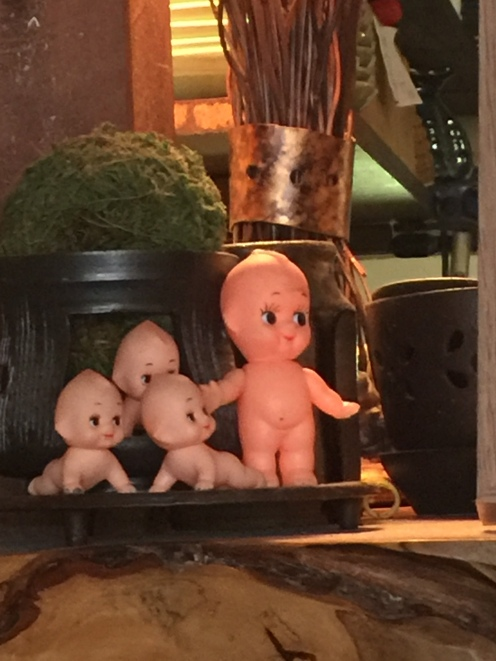 kewpie dolls on a bar at wabisabi salon in collingwood