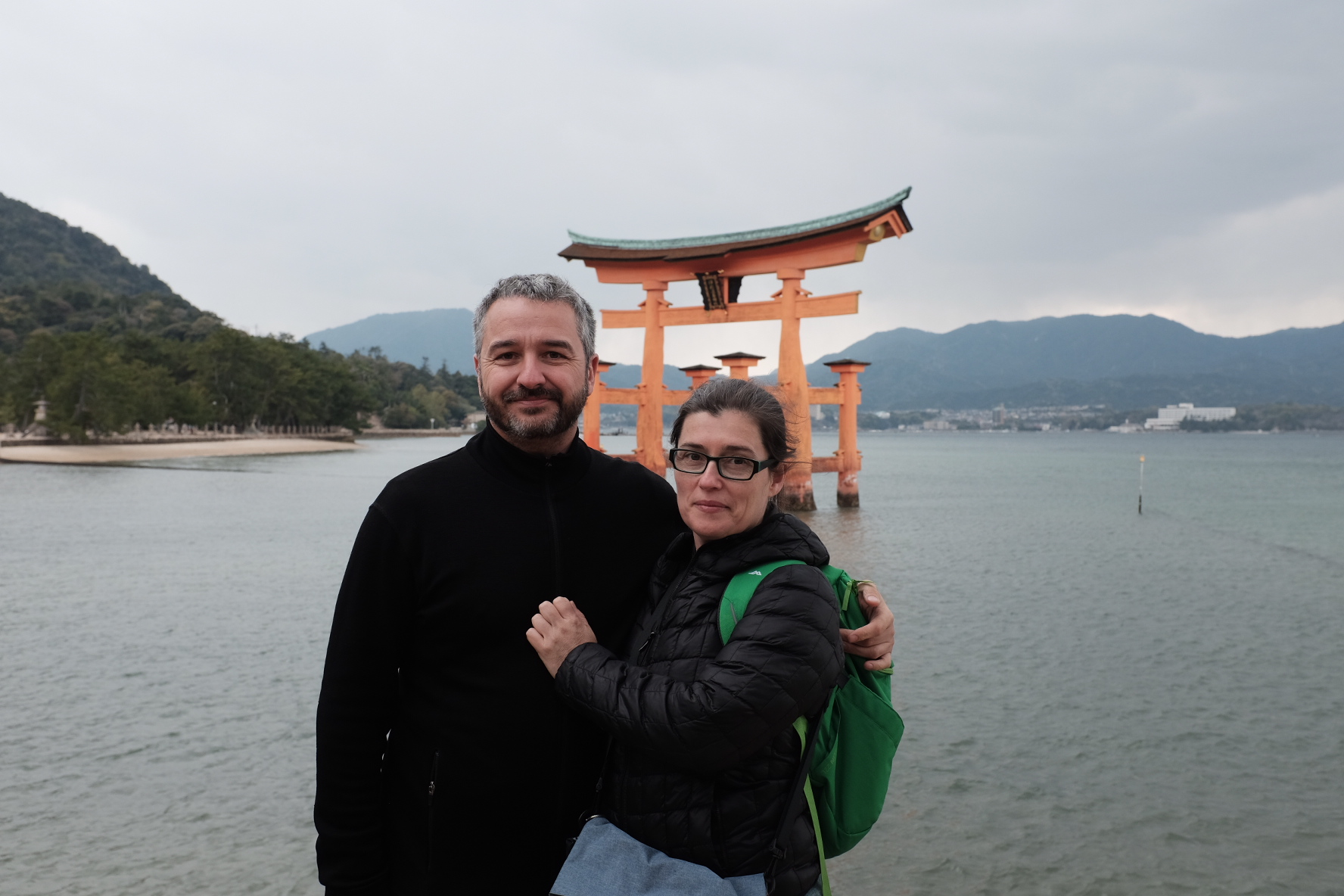 Super Sake Boy and Blossomkitty standing in front of the floating Tori at Utsukushima in Hiroshima