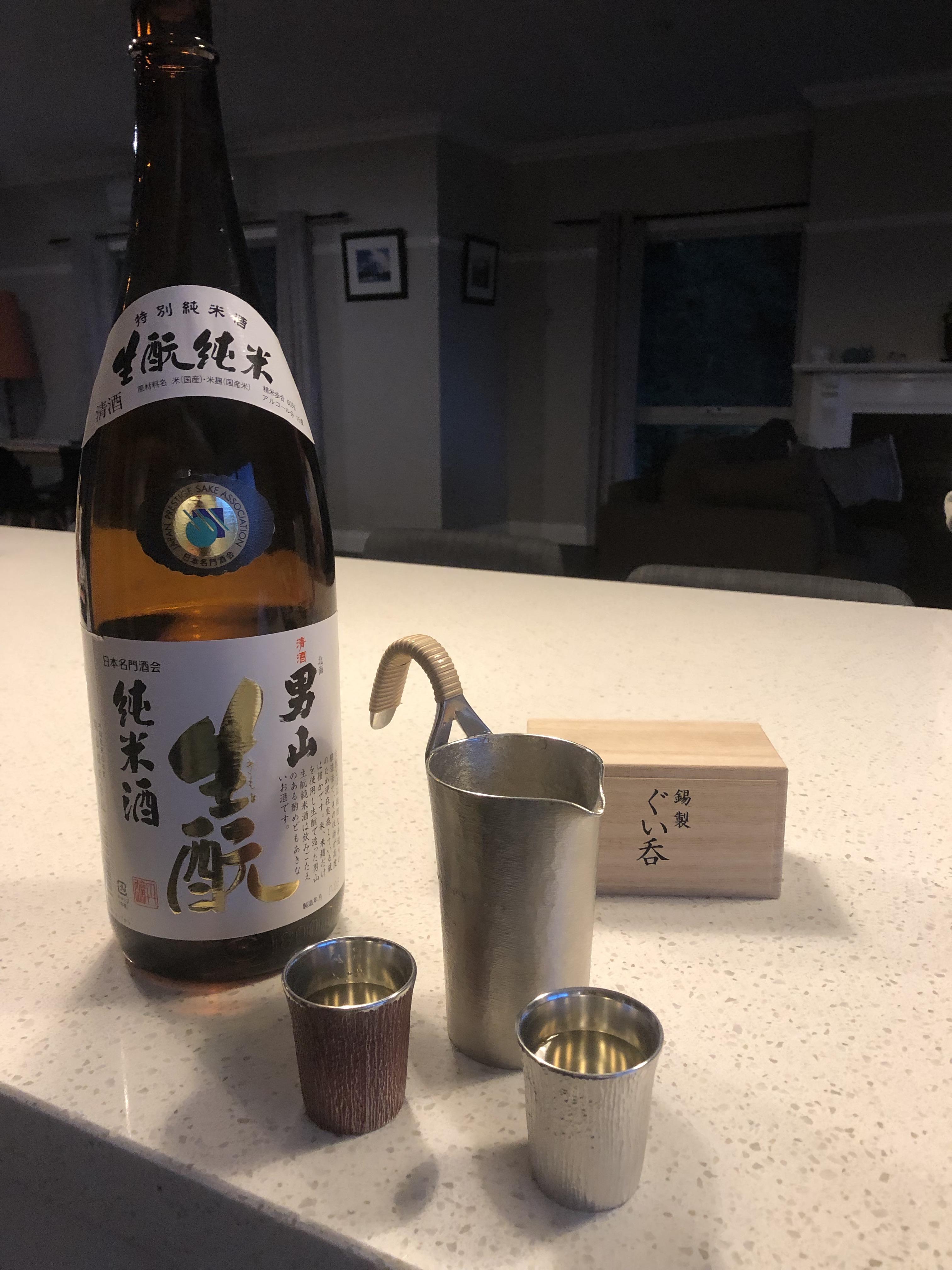 Otokoyama Kimoto Junmai 1.8 litre bottle with pewter tanpo and two pewter ochoko filled with sake from Hokkaido, Japan