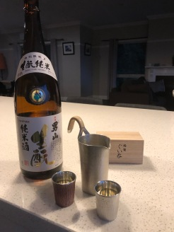Otokoyama Kimoto Junmai 1.8 litre bottle with pewter tanpo and two pewter ochoko filled with sake from Hokkaido, Japan
