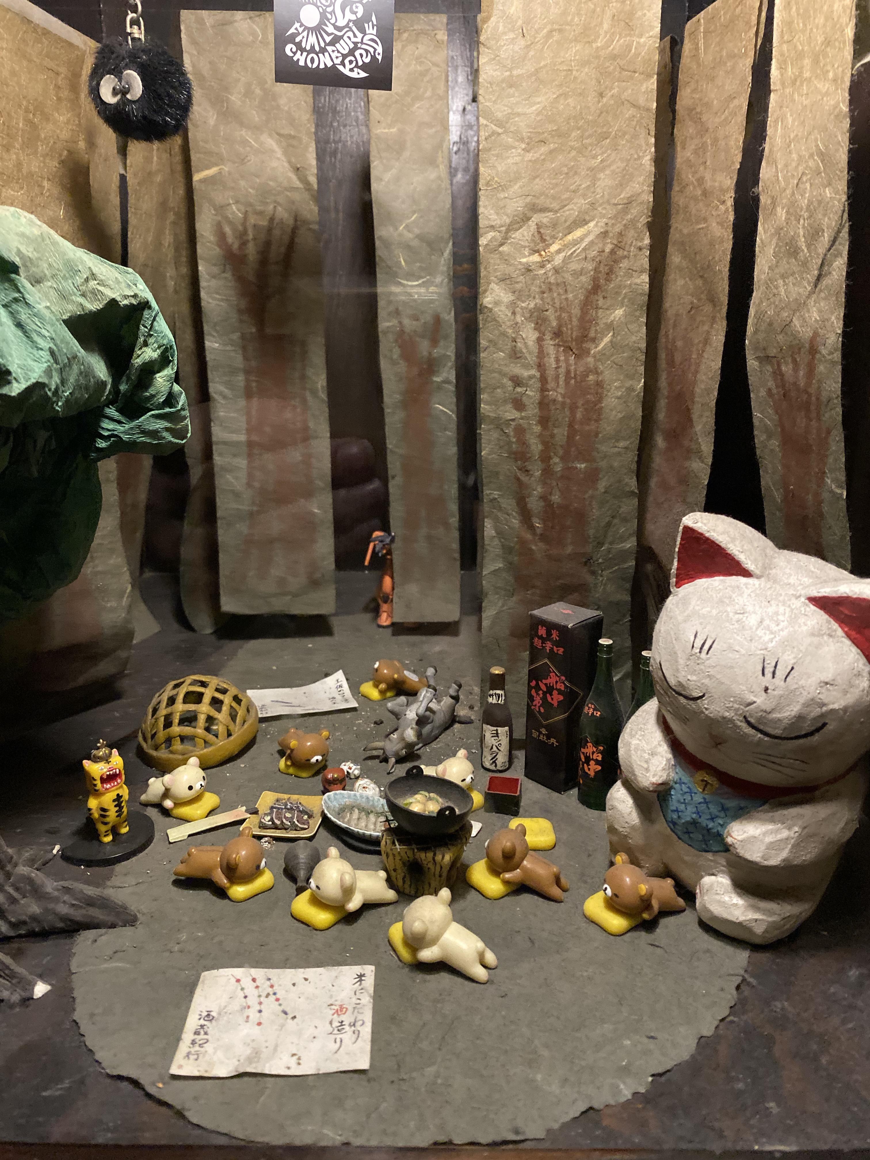 Display cabinet of cute Japanese toys at Sake Bar Decibel